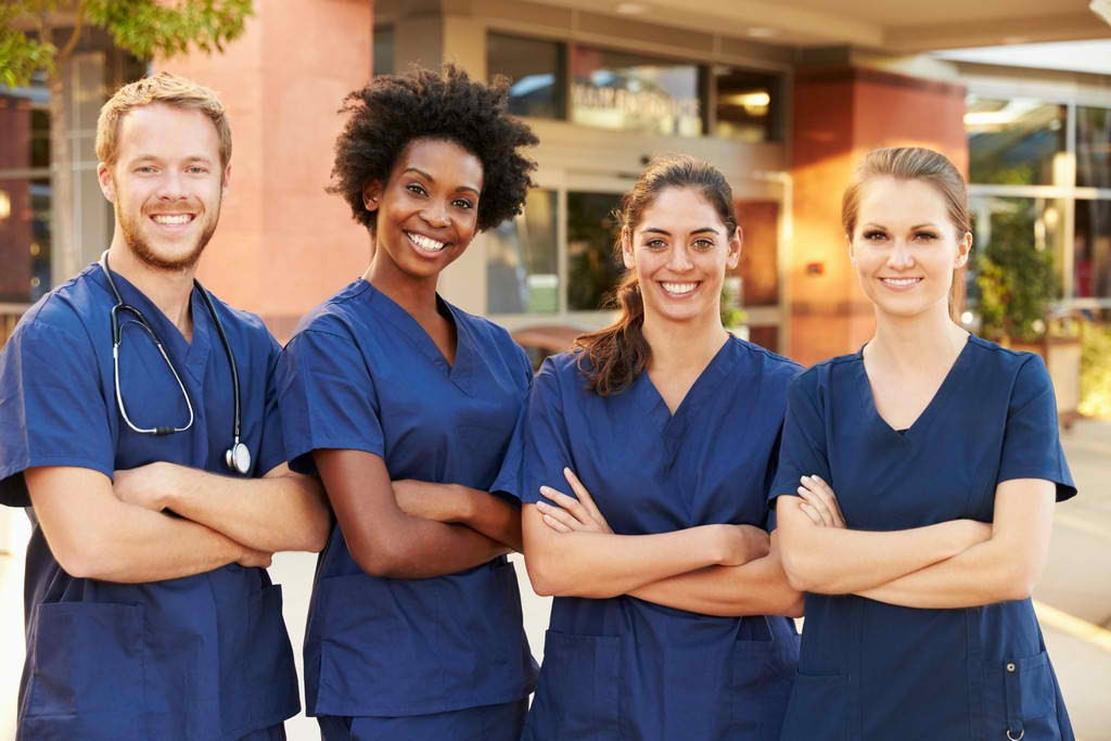 a group of healthcare workers  smiling