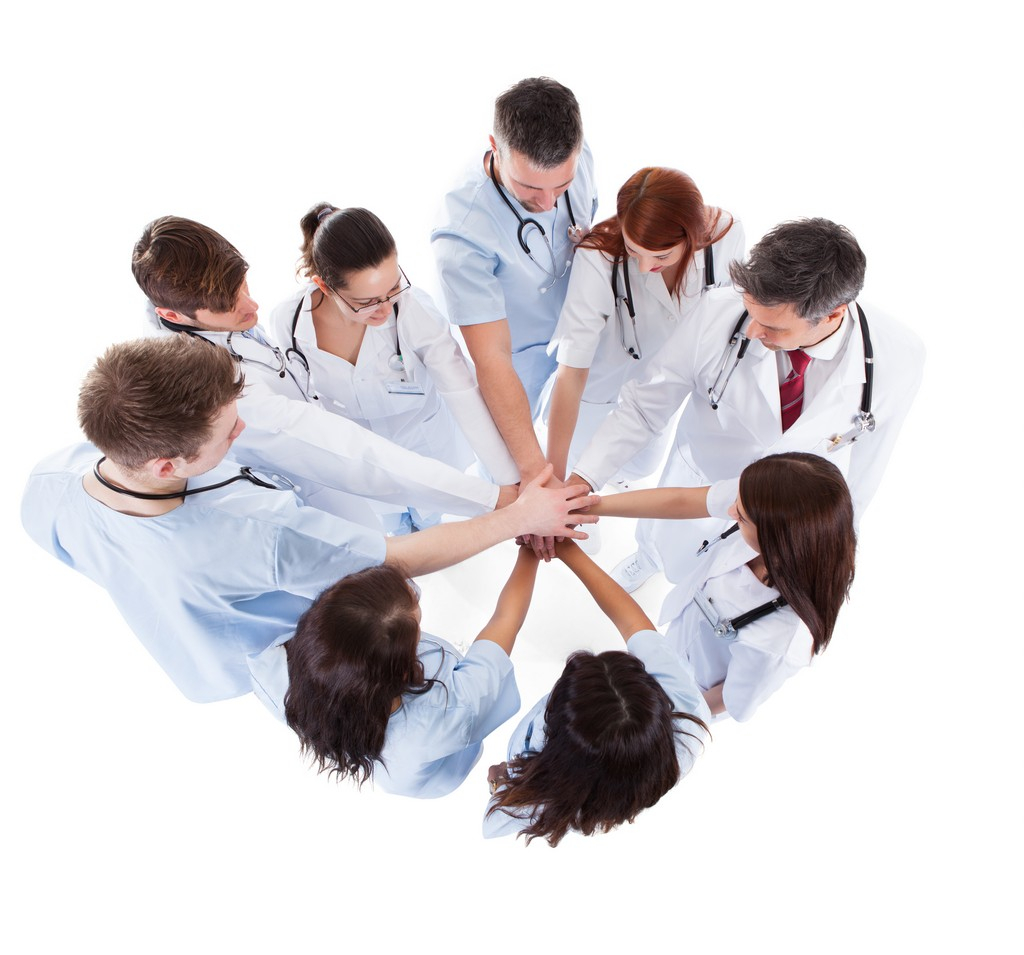 a group of healthcare putting their hands together