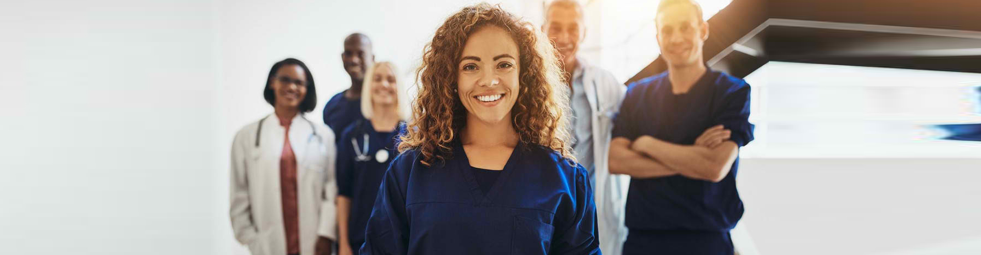 a group of medical workers smiling