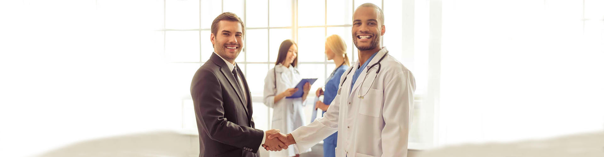 a businessman and a doctor shaking hands