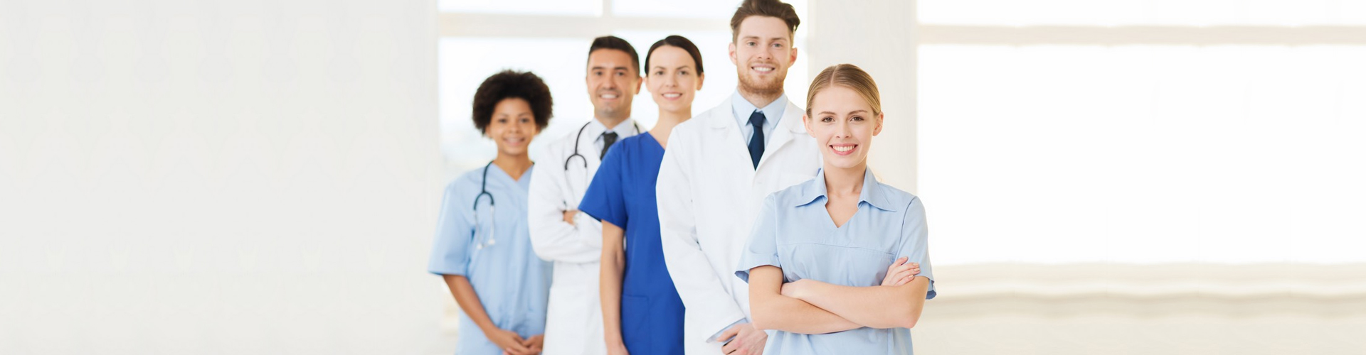 a group of medical staff smiling